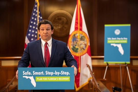 "Gov. Ron DeSantis announces his ""Safe. Smart. Step-by-Step. Plan for Florida's Recovery"" during a press conference Wednesday, April 29, 2020."