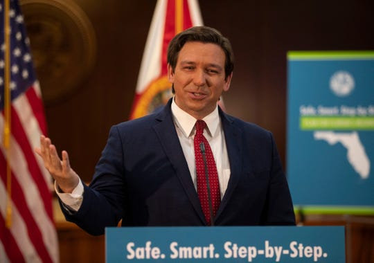"""Gov. Ron DeSantis announces his """"Safe. Smart. Step-by-Step. Plan for Florida's Recovery"""" during a press conference Wednesday, April 29, 2020."""