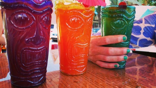 You can take home these plastic tiki glasses to fill up at home if you buy the bar's takeout tiki drinks. Party!