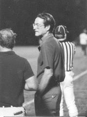 Peter Benedict, headmaster of St. Edward's School in Vero Beach 1970-1995, stands on the sideline of a football game in an undated photo. Benedict died April 25, 2020.