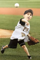 Jacob Wilson throws out the first pitch before a Pittsburgh Pirates game when he was 5 or 6 years old. Wilson's father, Jack, played 12 major league seasons, mostly with the Pirates.