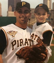 Jack Wilson holds his son Jacob during his playing days with the Pittsburgh Pirates.