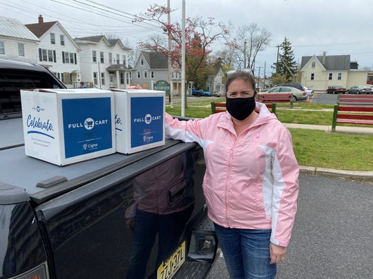 Betsy Loyle, a member of the Rotary Club of Vineland, was one of the many Rotarians helping to deliver boxes of nutritious food to local food pantries as part of the club's annual Hunger Project.