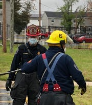 Vineland firefighters, seen here at the April 27, 2020 fire at Walnut Manor Apartments, are wearing face mask protection donated by Sally Huang, owner of Sushi Lover at the Cumberland Mall.