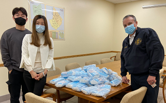 Sally Huang, owner of Sushi Lover at the Cumberland Mall, joined by her brother, David Huang, (left) donated 2,000 medical face masks she was able to purchase.  Lou Tramontana, chief of the Vineland Fire Department and Office of Emergency Management, accepted the supplies, which were distributed to area first-responders.