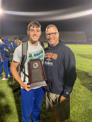 College of the Sequoias' track and field athlete Jackson Miller poses for a photo with his father, Brent. Jackson has signed to compete at Humboldt State next season.