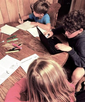 The kitchen table has turned into a classroom for the children of David and Ashley Beaver, who say having only one computer in the house makes scheduling classwork a little challenging.