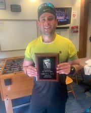 USA TODAY sports reporter Dan Wolken shows off his runner-up award from a USTA sanctioned tennis tournament in 2019.