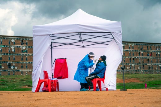 A residents from the Alexandra township gets tested for COVID-19 , in Johannesburg, Wednesday, April 29, 2020. South Africa will begin a phased easing of its strict lockdown measures on May 1, although confirmed cases of coronavirus continue to increase.
