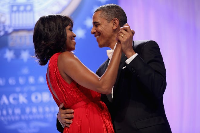Former president Barack Obama dances with Michelle Obama at the Inaugural Ball for his second term on Jan. 21, 2013 in Washington, DC.