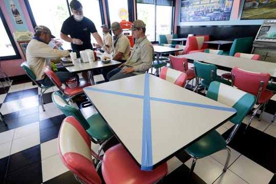 Tables are marked off for social distancing at Hwy 55 Burgers Shakes & Fries Monday, April 27, 2020, in Nolensville, Tenn. Monday is the first day Tennessee restaurants can reopen with reduced seating and social distancing during the coronavirus pandemic.