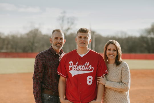 Palmetto third basemen Dylan Carter with his parents. Dylan's senior year was cut short due to COVID-19.