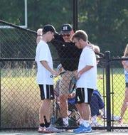 T.L. Hanna tennis coach Rob Spencer (center) coaching his son Austin (left) during the 2018 Elite Eight at Spartanburg High School.
