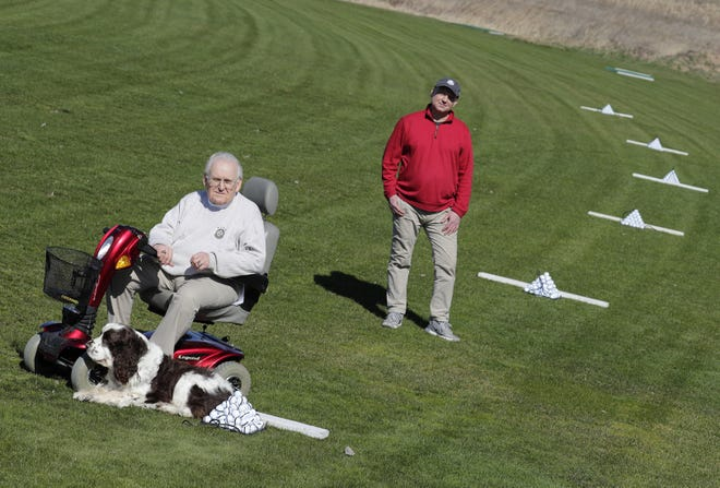 """Bob Burns, left, owner of Bob Burns Golf, and his son Robbie Burns are unable to open their driving range and pro shop under the state COVID-19 """"Safer at Home"""" restrictions. They are seen here at the driving range at 428 W. Edgewood Drive in Grand Chute."""