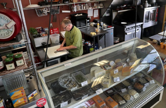 Bob Wall, co-owner of Green Gecko Grocer and Deli, will open a new location in the fall in downtown Appleton. Here, he's shown in the Richmond Terrace location that closed in October 2019.  (Photo: Wm. Glasheen/USA TODAY NETWORK-Wisconsin)