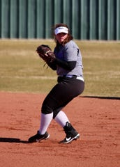 Wylie softball's Sydney Gilliam gets ready to throw to first base for an out.