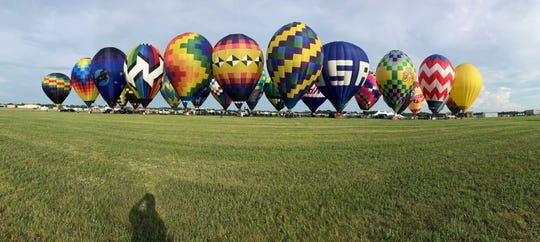Hot air balloons were standing on display during the 2019 Field of Flight. The event is cancelled for this summer.  Trace Christenson/The Enquirer