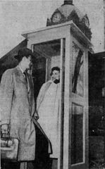 John McCurn, telephone representative, looks on as Dawn Abbott shows off the new telephone booth in 1952.