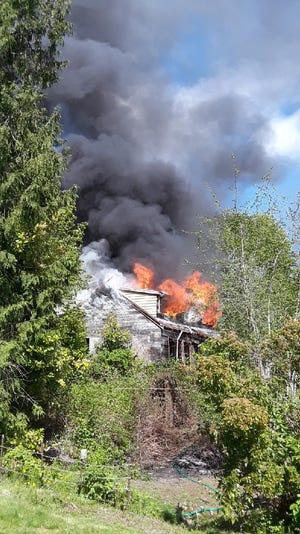 A fire caused heavy damage at an abandoned home on Viking Way Thursday morning.