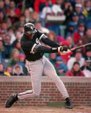 Chicago White Sox Michael Jordan follows through on his sixth-inning RBI double against the Chicago Cubs April 7, 1994 in Chicago.