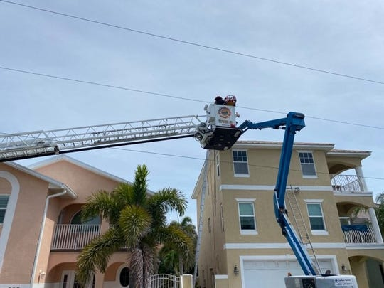 Cape Canaveral and Cocoa Beach fire crews work together to rescue a man who was nearly electrocuted while in a lift doing work on a home.