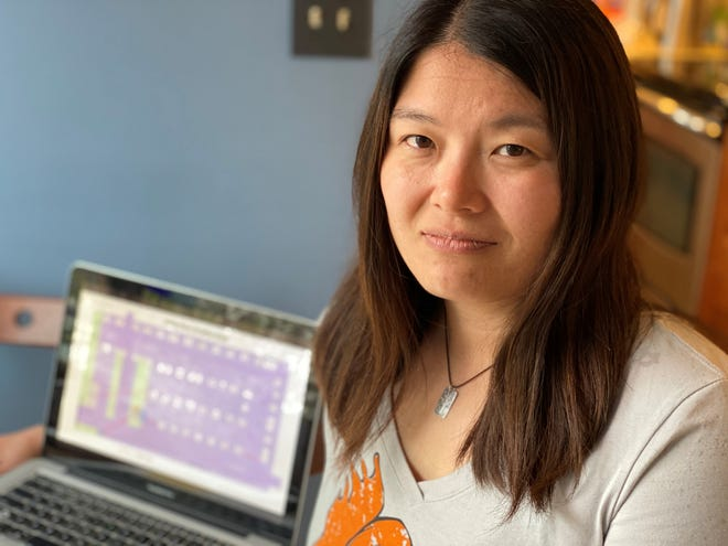 Mieko Ozeki, director of Burlington Farmers Market, pauses in her home office while working on a map of vendors on April 30, 2020. This year's outdoor market will launch June 6 — a month later than usual; and has a tentative closing date of Oct. 17 — two weeks earlier than the norm.
