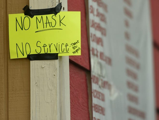 """""""No mask no service"""" is seen at outside of Chatitos Snacks, Wednesday, April 29, 2020, in Hebbronville, Texas. The county required masks for every person after cases in Laredo increased."""