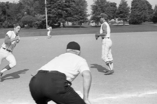 Chip Maxwell rounds third with the winning run. Zane Trace defeated Columbus Bishop Wehrle 2-1 in May 1970.