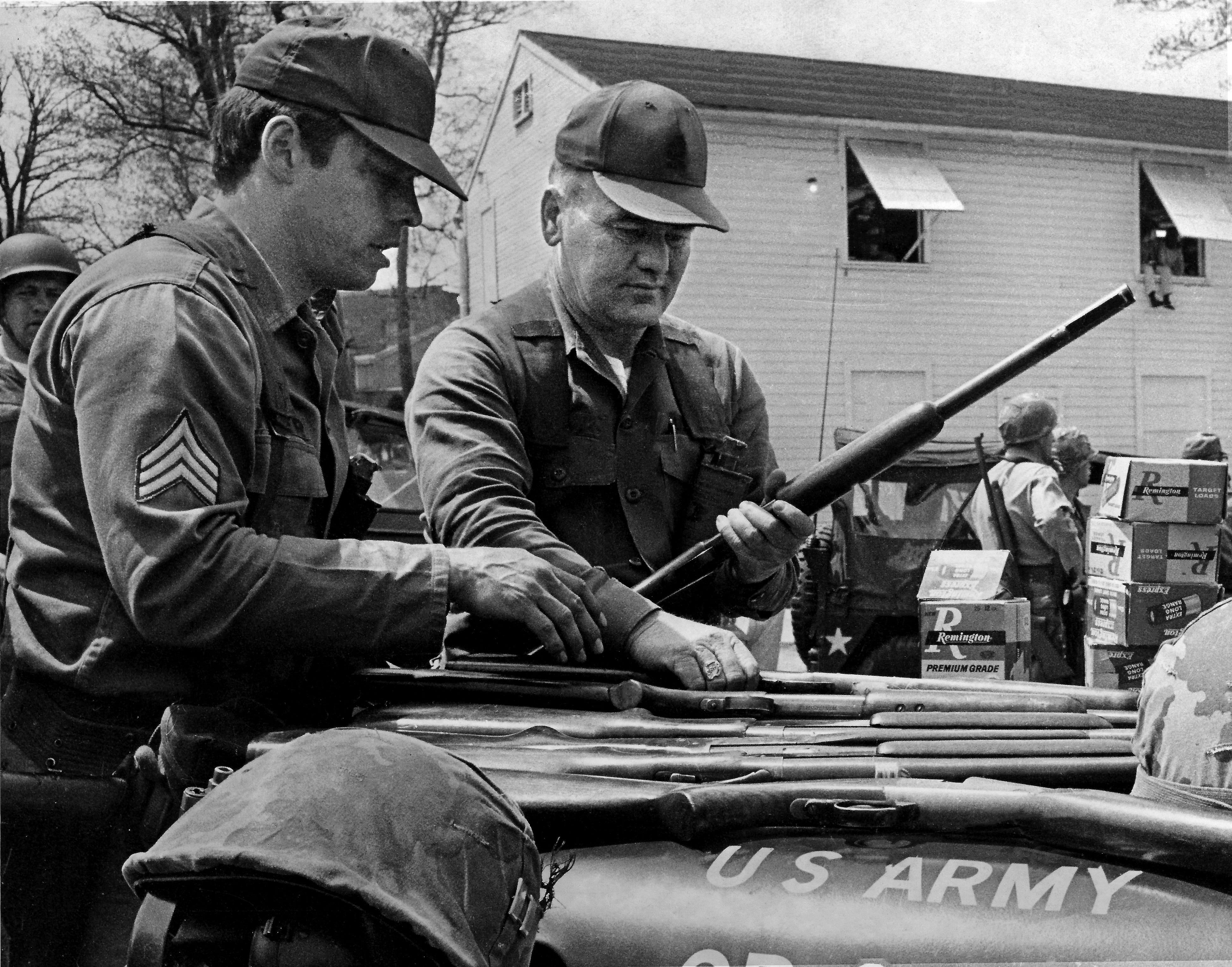 Boxes of shotgun ammunition are stacked on top of an Army jeep as Ohio National Guardsmen load shotguns at Kent State University on May 4, 1970, as they prepare to again confront student protesters on campus. At the same time, faculty marshals were pleading with the crowd to disperse following the deaths of four students earlier that afternoon.