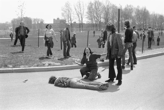 Teenager Mary Ann Vecchio screams as she kneels over the body of Kent State University student Jeffrey Miller who had been shot during an anti-war demonstration on the university campus on May 4, 1970. The protests, initially over the US invasion of Cambodia, resulted in the deaths of four protesters, including Miller, and the injuries of nine others after the National Guard opened fire on students. A cropped version of this image won the Pulitzer Prize.