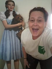 Michelle Luken posing with a life size cut out of Dorothy, from the Wizard of Oz.
