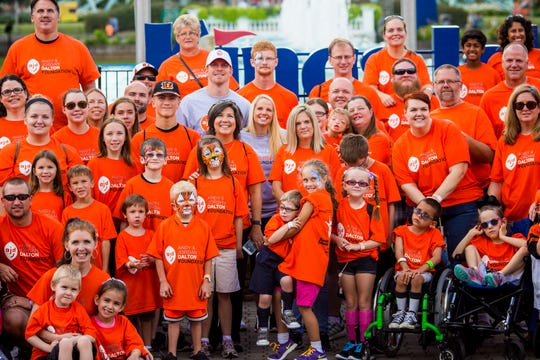 "Andy and Jordan Dalton pose for a photo with the families at the ""King for a Day"" community outreach program hosted by The Andy & Jordan Dalton Foundation at Kings Island Saturday, August 20, 2016 at Kings Island in Mason, Ohio. The families got to enjoy an all-expense-paid dream day with the Daltons."