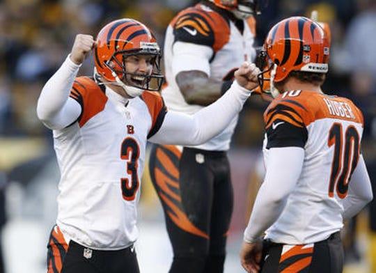 Cincinnati Bengals kicker Josh Brown (3) celebrates their 13-10 win on a game winning field goal beating the Pittsburgh Steelers at Heinz Field in Pittsburgh.