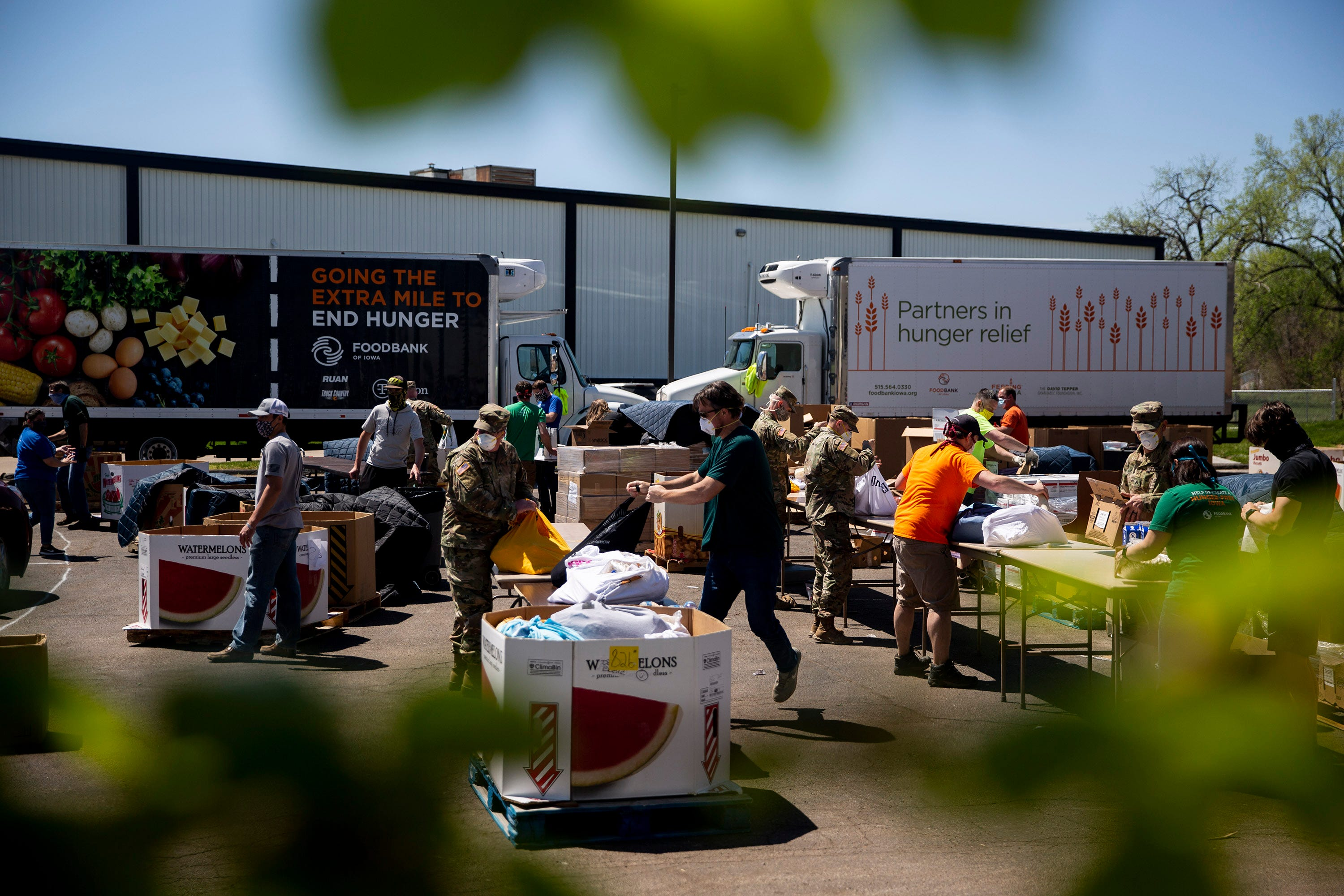 Members of the Iowa National Guard help distribute food from the Food Bank of Iowa on Thursday, April 30, 2020, in Des Moines, Iowa.