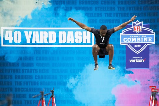 Wisconsin receiver Quintez Cephus jumps up to stretch before running the 40-yard dash during the NFL combine Feb. 27, 2020 in Indianapolis.