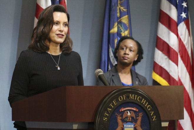 Gov. Gretchen Whitmer speaking at the COVID-19 news conference in Lansing Wednesday, April 29, 2020. Michigan Department Healthy and Human Services Chief Medical Executive Dr. Joneigh Khaldun is pictured at right.