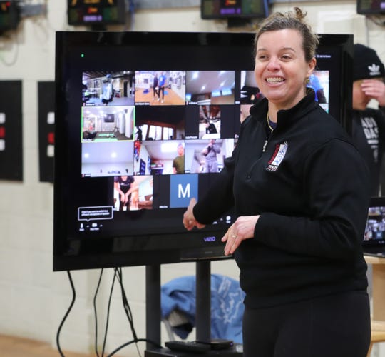 Dr . Ann Marsh-Senic a Olympian teaches Fencing with her husband Anatolie Senic are using the internet to teach their classes due to COVID-19 Monday 30, March 28, 2020 in Troy.