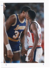 Isiah Thomas and Magic Johnson pregame kiss during the 1989 NBA Finals at the Palace of Auburn Hills.