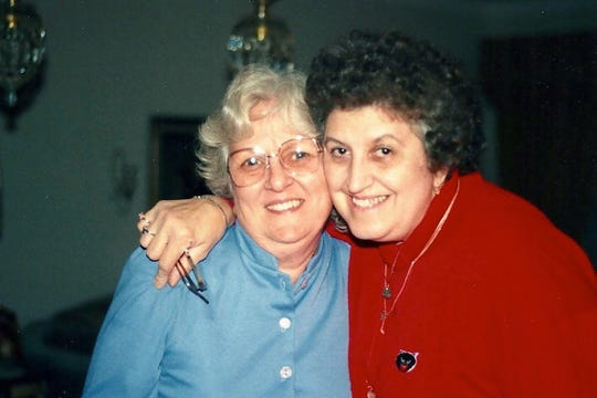 Lifelong friends Mary Hackett, left and Jessie Ancona, both 91, on Halloween, 1988. They died just days from each other from COVID19.