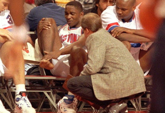 Isiah Thomas after injuring his right foot in his final NBA game April 19, 1994 at the Palace of Auburn Hills.