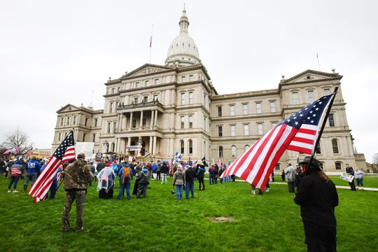 "Protesters at the ""American Patriot Rally,"" gathered at the Michigan Capitol in Lansing to voice displeasure for Gov. Gretchen Whitmer's coronavirus pandemic polices, on April 30, 2020."