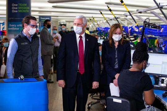 Vice President Mike Pence tours the General Motors/Ventec ventilator production facility with GM CEO and Chairman Mary Barra, second from right, and Chris Kiple of Ventec, left, in Kokomo, Ind., Thursday, April 30, 2020.