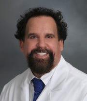 Dr. Mark E. Schweitzer
