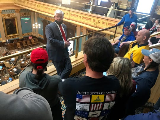 Michigan Senate Majority Leader Mike Shirkey, R-Clarklake, talks to protesters in the Senate gallery on Thursday, April 30, 2020.