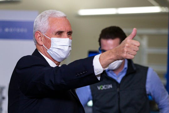 Vice President Mike Pence gestures while visiting the General Motors/Ventec ventilator production facility in Kokomo, Ind., Thursday, April 30, 2020.