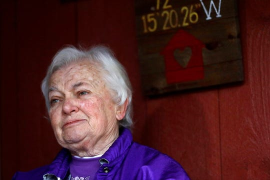 Alice Lowell, of Hardwick, Mass., who lost her husband to the coronavirus, speaks to a reporter from The Associated Press on the front porch of her daughter's home, Thursday, April 30, 2020, in Ware, Mass.