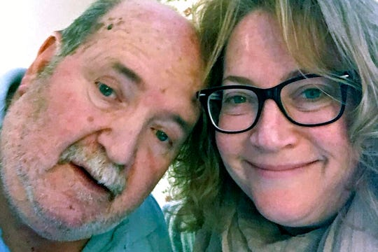 This undated selfie photo provided by Susan Kenney shows Kenney with her late father Charles Lowell, when he resided at the Holyoke Soldiers' Home in Holyoke, Mass. Lowell died April 15, 2020, after contracting the new coronavirus while residing at the veterans' home. He was 78.