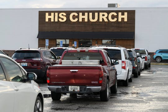 Vehicles fill the parking lot outside of HIS Church in Owensboro, Ky., for a modified drive-in church and communion service, Wednesday evening, April 29, 2020. Earlier that afternoon, Gov. Andy Beshear announced a plan to reopen houses of worship for in-person services on May 20.