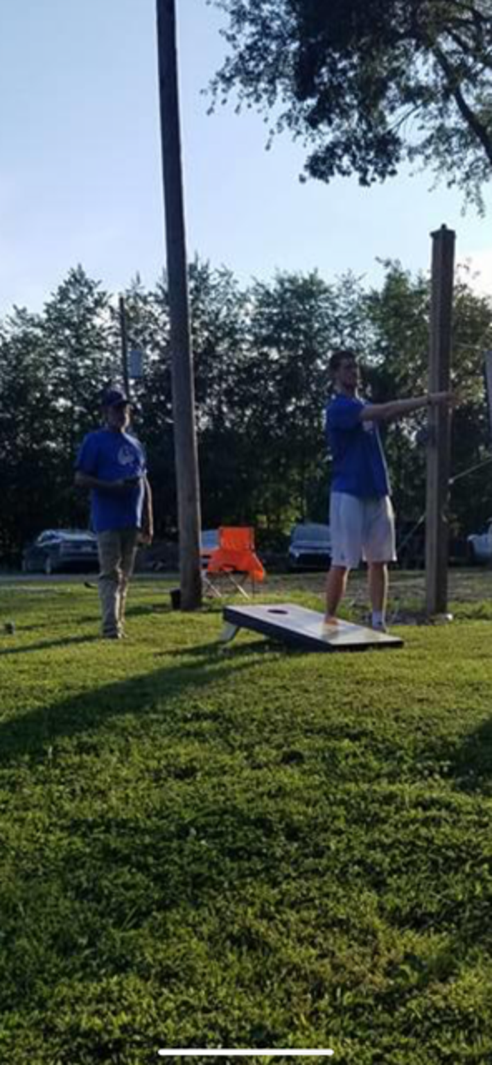 Justin Carpenter (right) plays cornhole with his uncle Sonny (left). His uncle passed away due to complications from lung cancer the night before his first home game at Wabash Valley College.
