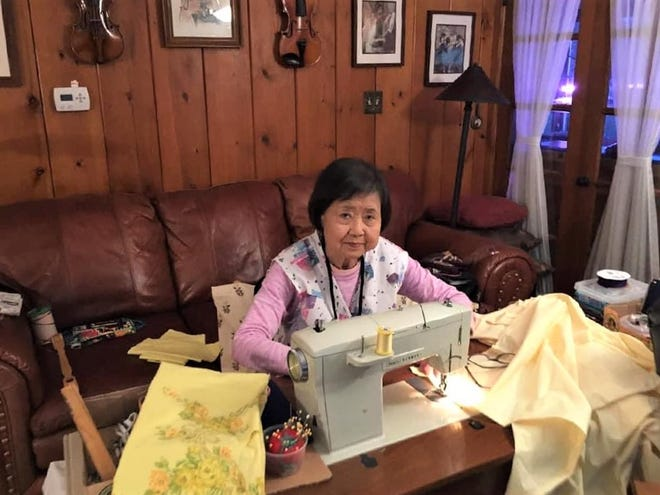 Shin Ae Zeigler of Fond du Lac sews medical gowns out of sheets to send to healthcare workers on the Navajo Nation in Arizona, where her daughter Christina Zeigler works as dentist. The Navajo Nation is currently experiencing the third highest number of Covid-19 cases in the U.S. - behind only New York and New Jersey.